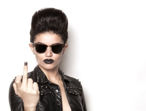 Beautiful rocker girl wearing a leather jacket and sunglasses